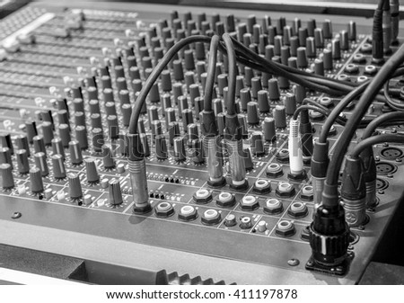 Black and white studio radio mixing. Audio music mixer. Digital sound equipment. Professional equalizer for concert mix, volume control, electronic instrument. Broadcast switch. Record technology. - stock photo