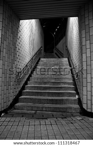 Black and white subway entrance.