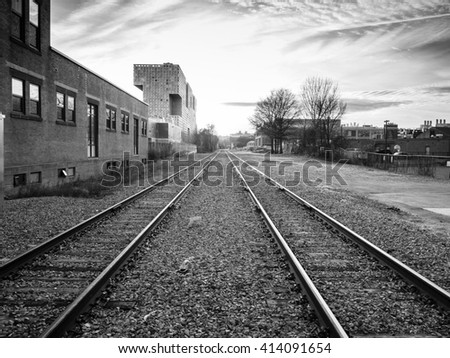 Black and white sunset over train tracks behind MIT in Cambridge, MA - stock photo