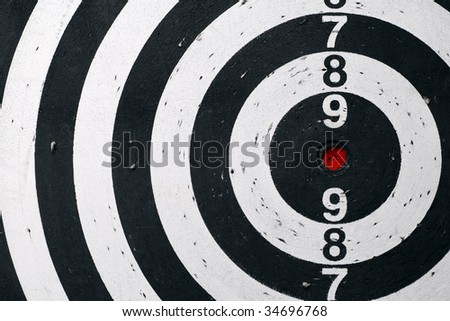 Black and white target sheet with red target.