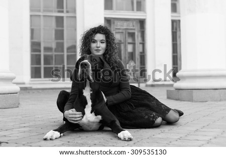 Black and White. The great dane and  woman walking outdoors