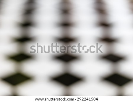 black and white tiles floor in blur and de focus , abstract background and textures - stock photo