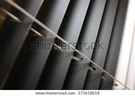 Black and white venetian blinds - stock photo