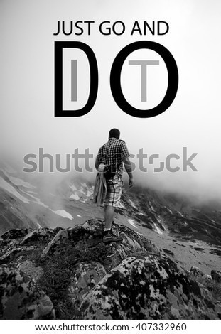 """black and white vertical motivational poster with man climbing and """"go and do it """" conceptual text added  - stock photo"""
