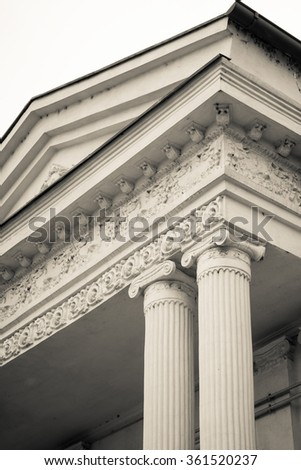 Black and white view of a couple of pillars. Vertical black and white view of a pair of collumns, in a summer day.