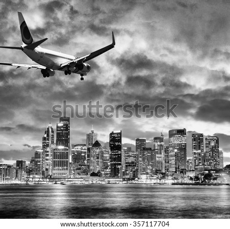 Black and white view of airplane over Sydney. Tourism concept. - stock photo