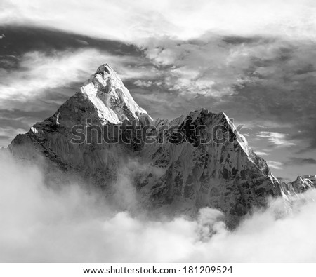 Black and white view of Ama Dablam with and beautiful clouds - Sagarmatha national park - Khumbu valley - Trek to Everest base cam - Nepal - stock photo