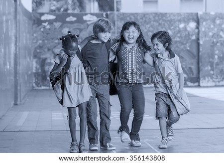 Black and white view of elementary multiethnic classroom. Primary school concept. - stock photo