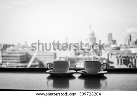 black and white view of London with two cups of coffee near St Paul cathedral - stock photo