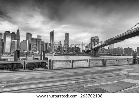 Black and white view of Manhattan from Brooklyn Bridge Park, New York. - stock photo