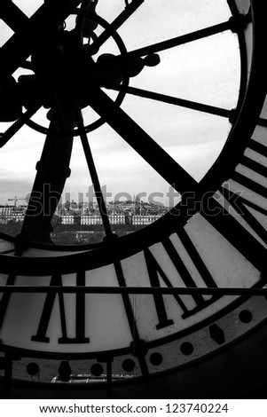 Black and White view of Sacre-Coeur in Montmarte Through the Clock at the Musee D'orsay in Paris France - stock photo