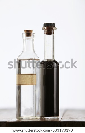 black and white vinegar on the wooden table top