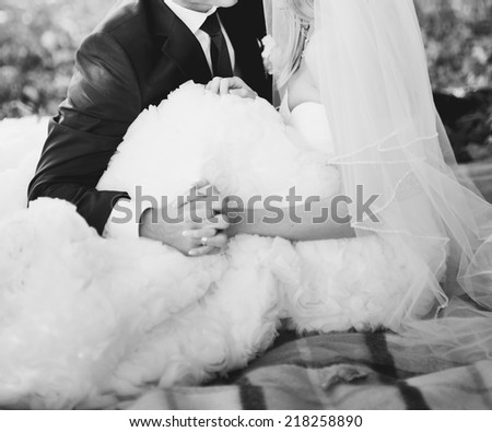 Black and white wedding picture. Newlywed couple holding hands,   - stock photo