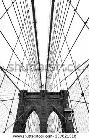 Black and white wide angle view of the Brooklyn Bridge in New York City. - stock photo
