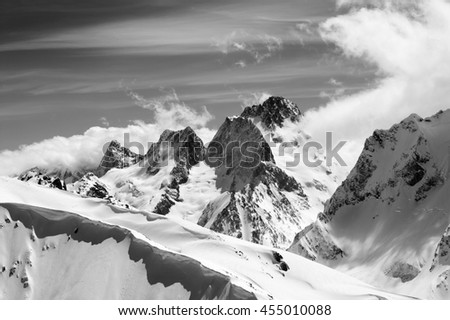 Black and white winter mountains with snow cornice. Caucasus Mountains, region Dombay. - stock photo