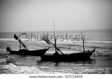 black and white wooden boat on the beach
