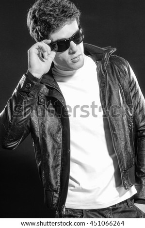 black and white young casual man in sunglasses - stock photo