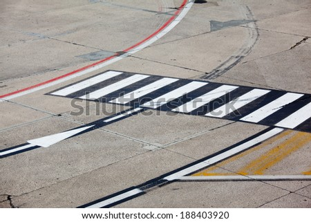 black and yellow airport markings on concrete - stock photo