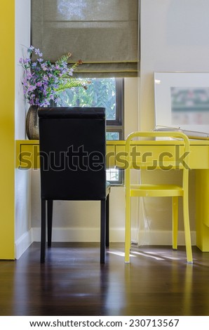 black and yellow chair in working area at home