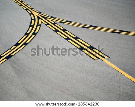 Black and yellow runway guideline for the plane at airport - stock photo