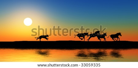 Black animal silhouettes by a river.