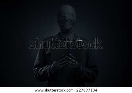 Black Art, a man in a black suit, tied head, loneliness, depression - stock photo