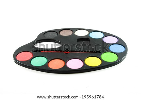 black art palette with paint and brushes isolated on white - stock photo