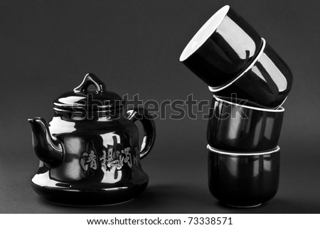 black asian tea set on black background