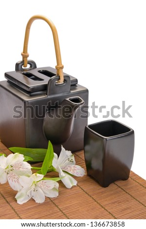 Black asian teapot and cup isolated