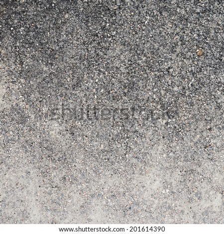 Black asphalt fragment as a background texture - stock photo