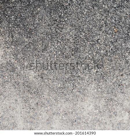 Black asphalt fragment as a background texture - stock photo