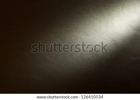 Black background illuminated from the right corner spotlight and vintage grunge background texture, black and white background for printing monochrome brochure, web ad, elegant dark gradient - stock photo