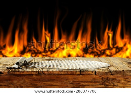 black background of fire and table of wood grate and free space for you  - stock photo