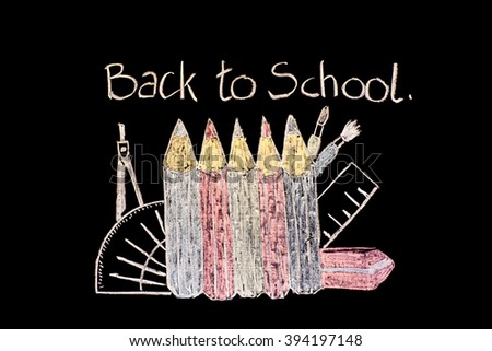 """Black background with the words """"Back to School"""" wriiten in the style of a school chalkboard and showing a ruler, a compass, paint brushes, coloured pencils and an eraser. - stock photo"""