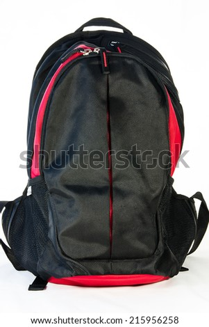 Black backpack standing isolated on white background