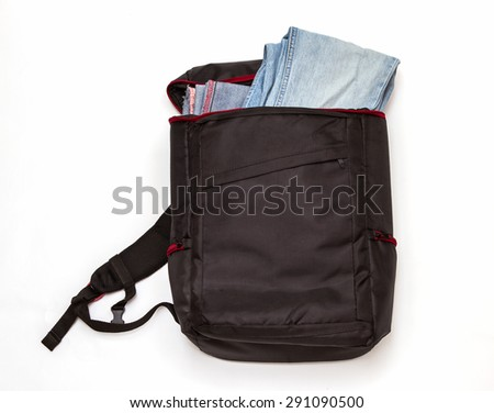 Black backpack standing on white background for design.