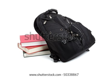 Black backpack with books on a white background