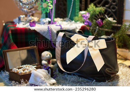 black bag as a gift on decorated Christmas  background