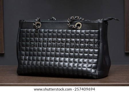 black bag on a shelf in a store.  - stock photo