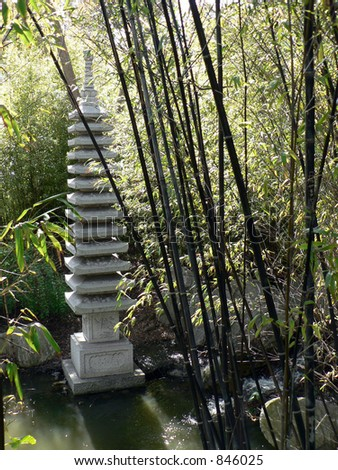 Black Bamboo surrounding a statue in a Chinese garden