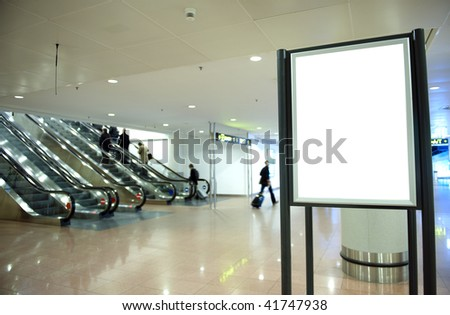 Black banner at airport with blured people - stock photo