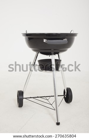 Black barbecue grill on white background - stock photo