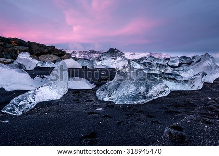 black beach and icebergs at crystal beach in Iceland - stock photo