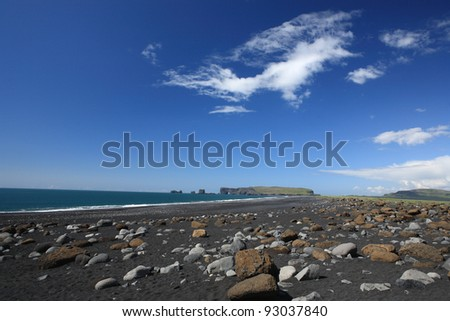 Black beach at Reynisfjara near Dyrholaey and Vik in Myrdal, Iceland - stock photo