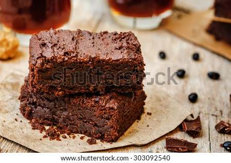 black bean brownies on a dark wood background. the toning. selective focus - stock photo