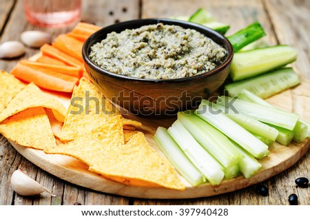 black bean dip with vegetables and corn chips. toning. selective focus - stock photo