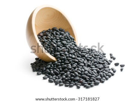 black beans in bowl on white background