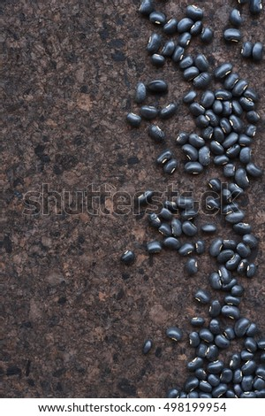 Black beans on wooden table for background