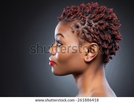 Black beauty with short spiky red hair - stock photo