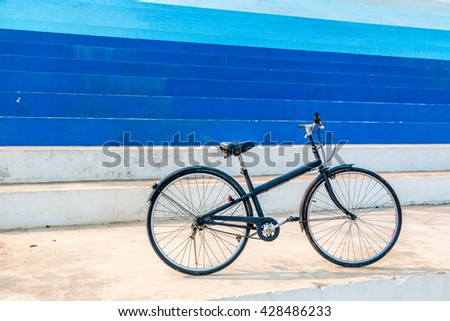 Black bicycle and vintage wall.  cycling at the out side, old bike in city urban environment.